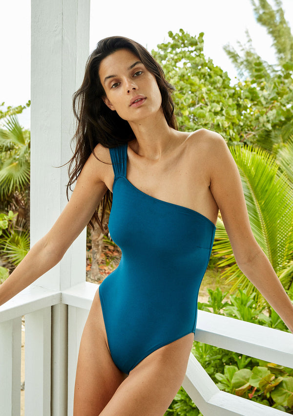Asymmetric onepiece made from sustainable fabrics, ethically made. Sustainable swimwear brand from Barcelona.