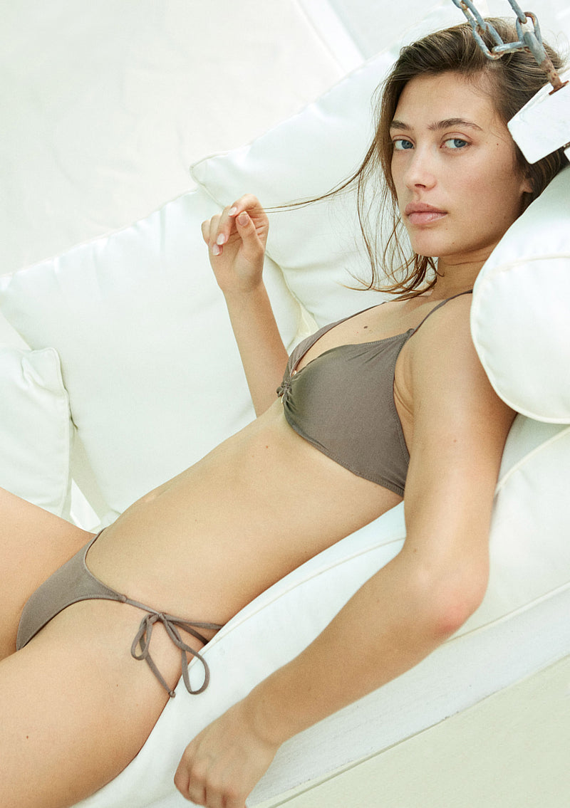 Strappy bikini bottom made from sustainable fabrics, ethically made. Sustainable swimwear brand from Barcelona.