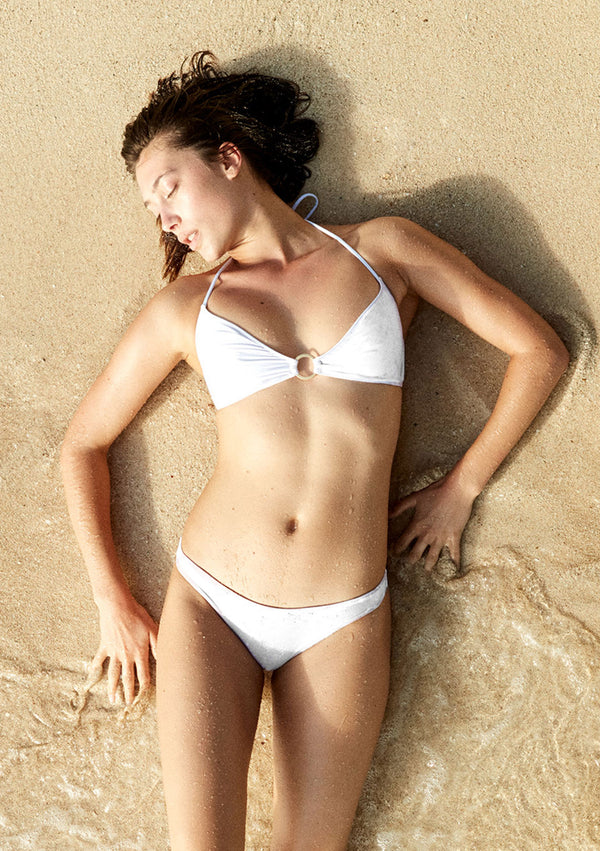 Cheeky white bikini bottom made from sustainable fabrics, ethically made. Sustainable swimwear brand from Barcelona.