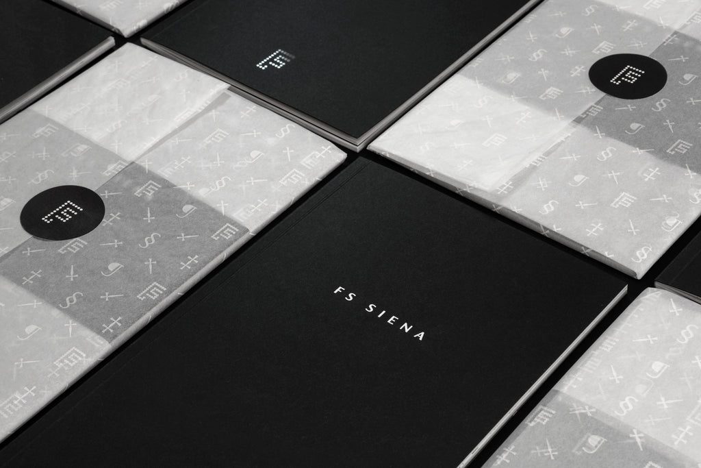 FS Siena | Limited edition brochure features a variety of paper stocks wrapped by hand in bespoke tissue paper.