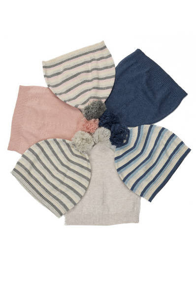 circle of cashmere infant hats in stripes and solids with pom poms
