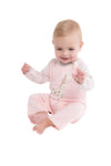 baby wearing pink  giraffe cashmere coverall sitting down