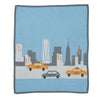 chambray blue new york blanket with taxi design