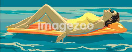A sunbather relaxes on an inflatable at sea