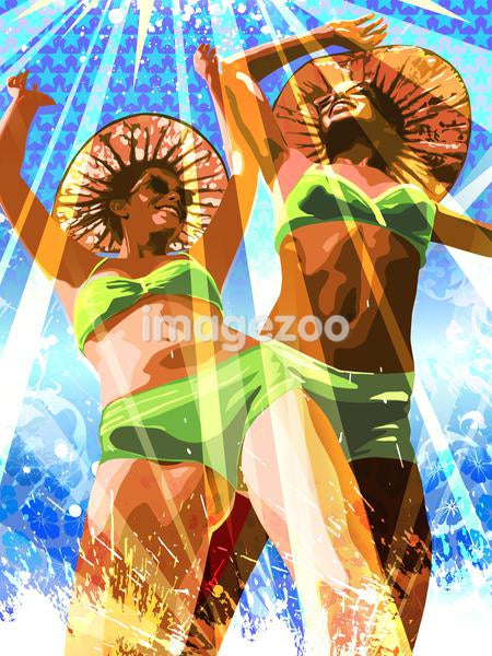 Two women dancing at the beach
