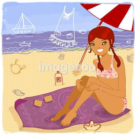 Young woman at beach, sitting under an umbrella