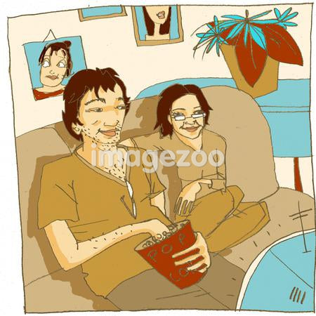 Couple sitting on couch, eating popcorn and watching television
