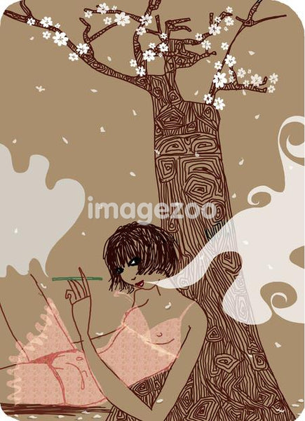 Woman sitting under a tree and smoking