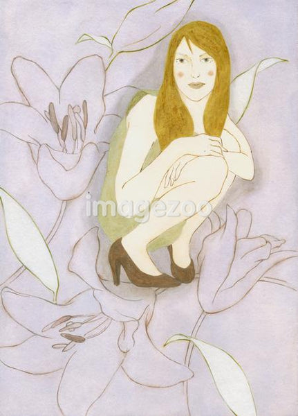 A woman crouched in a flower