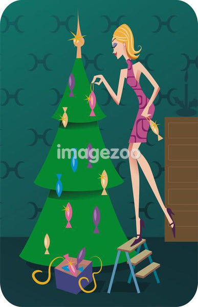 A Pisces woman decorating a Christmas tree with fish decorations