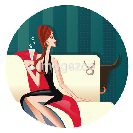 A Taurus woman sipping champagne on a sofa