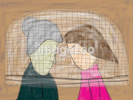 Two women underneath a net