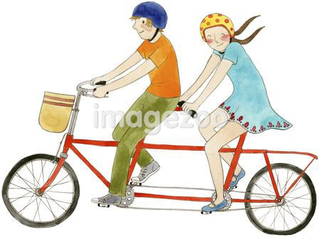 A couple on a tandem bicycle