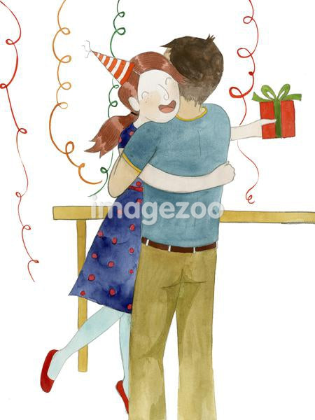 A girl hugging a boy at her birthday party