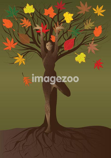A woman in a yoga pose standing against a tree with colorful leaves