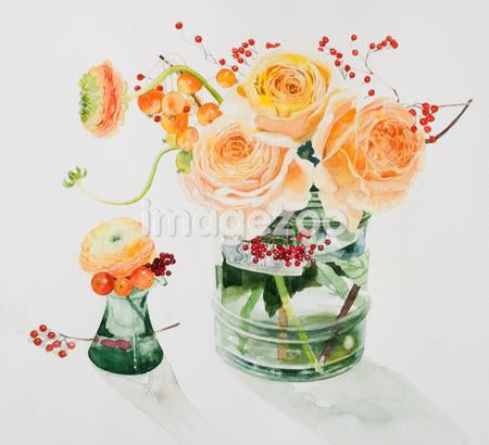 A vase of apricot colored roses