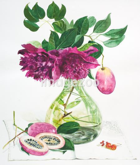 A vase with purple fruits and flowers