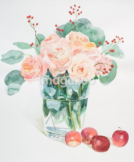 A tall vase filled with apricot colored roses