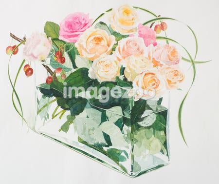 A rectangular vase of apricot colored roses