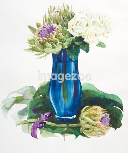 A tall blue vase filled with flowers