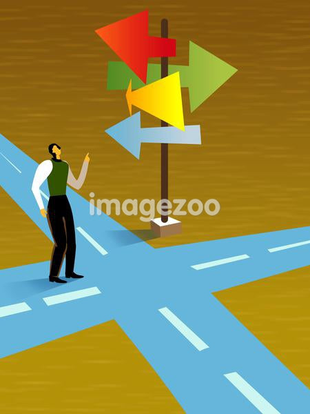 A businesswoman at a crossroads deciding which path to go
