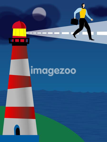 A businessman walking on a path that is lit by a lighthouse