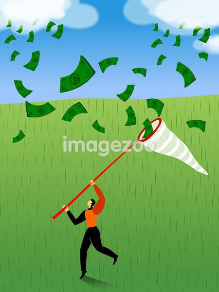 A businessman catching money with a net