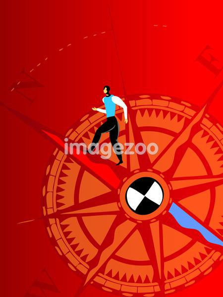 A businessman standing on a compass