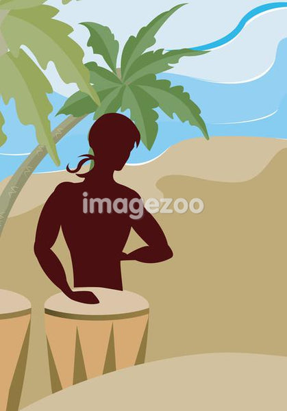 A silhouette of a man playing the bongo drums on the beach