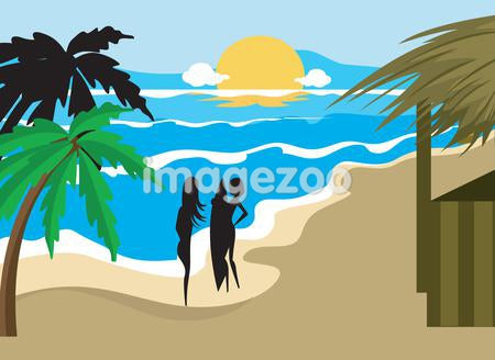 Silhouettes of two women with surf boards at the beach