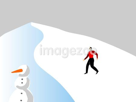 A man walking up a snow covered mountain