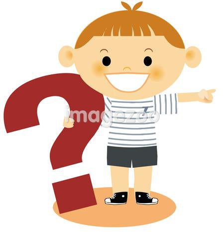 A young boy pointing holding a large question mark