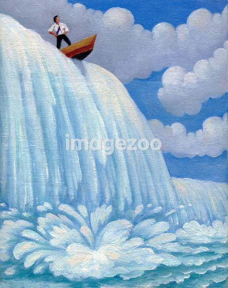 A businessman in a boat going over a waterfall