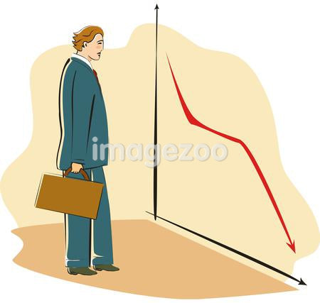 A businessman looking at a graph