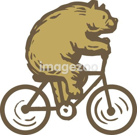 A bear riding a bike