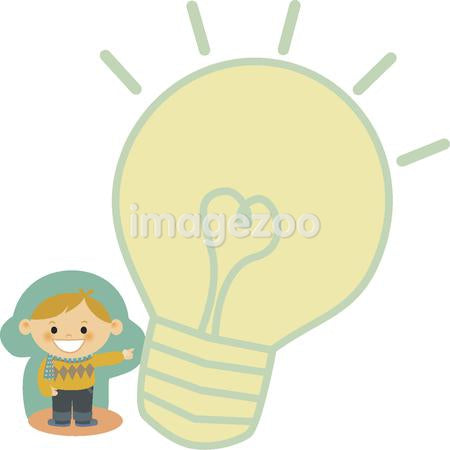 A boy pointing to a light bulb