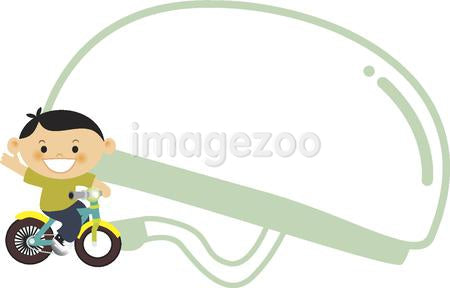 A boy riding a bike with a bike helmet in the background