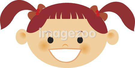 A smiling girl with red hair in pigtails