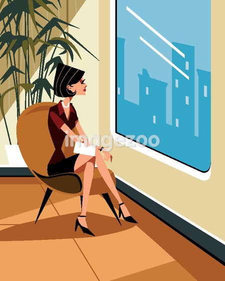 A woman looking out of her office window
