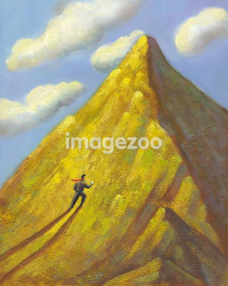 A businessman climbing a mountain