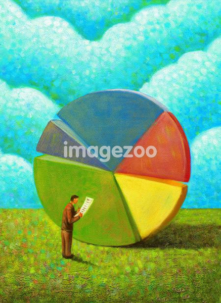 A businessman looking at a pie chart