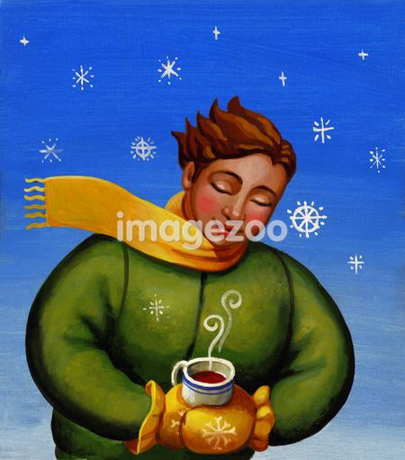 A person holding a hot cup of coffee on a cold winter's day