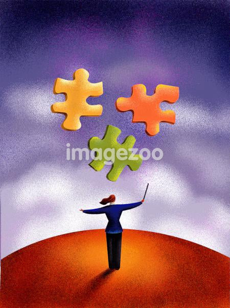 A businesswoman conducting puzzle pieces