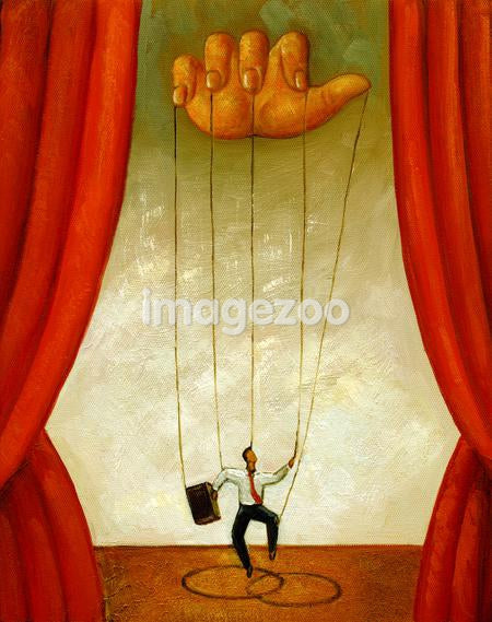 A businessman as a puppet being controlled by a large hand