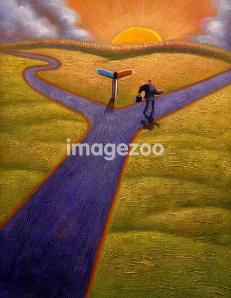 Businessman taking one of two paths at a fork in the road