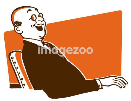 A jolly looking businessman sitting at a desk