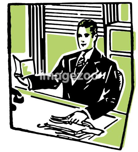 A businessman sitting at his desk