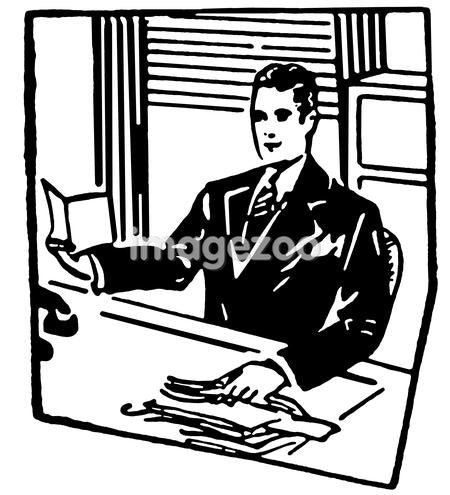 A black and white version of a businessman sitting at his desk