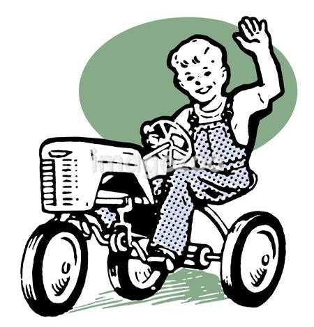 A young boy playing on a tractor