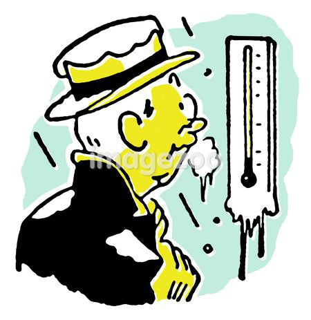 A man freezing whilst checking a thermostat